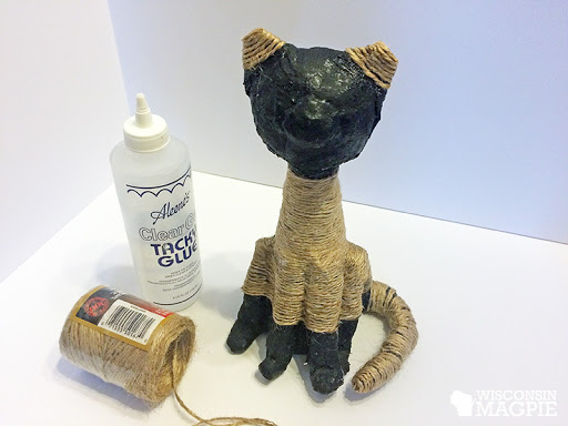 covering a paper mache cat in jute twine
