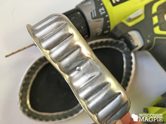 drilling a hole in a metal pan