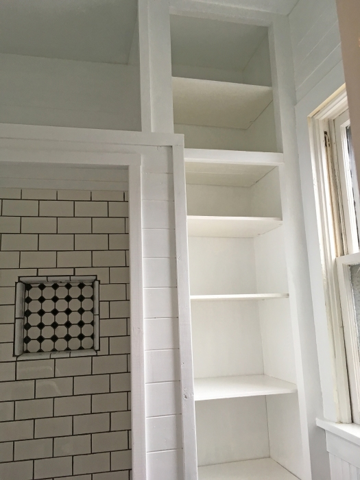 bathroom cabinet with fresh coat of white paint on interior