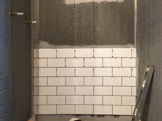 shower stall with seven rows of tile laid