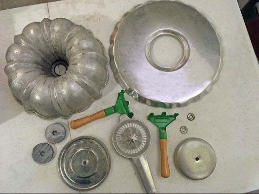 Bundt pan, aluminum juicer, lids and garden trowels used to assemble a junk turkey