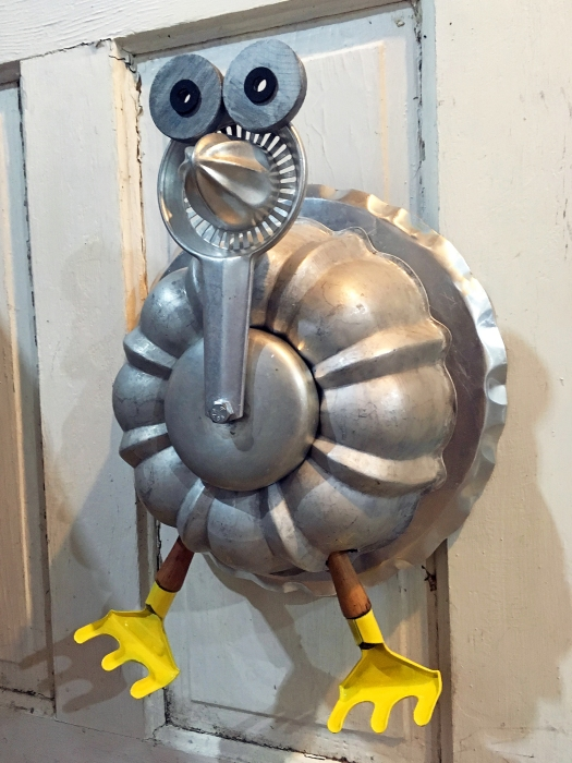 Turkey assemblage made from metal and aluminum kitchenware and garden trowel feet
