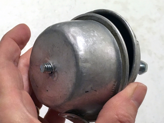 Funnel and measuring cup held together by a bolt
